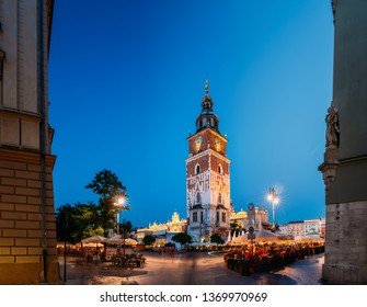 Krakow, Poland. Famous Landmark On Old Town Square In Summer Evening. Old Town Hall Tower In Night Lighting. UNESCO World Heritage Site.