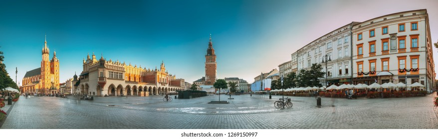 Krakow, Poland. Famous Landmarks On Old Town Square In Summer Evening. St. Mary's Basilica, Cloth Hall Building And Old Town Hall Tower. UNESCO World Heritage Site. Panoramic View