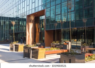 KRAKOW, POLAND - February, 6, 2018:  Modern office building with facades made of glass and outdoor empty seating area