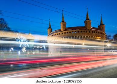 Krakow, Poland, gothic barbican in the night and traffic light trails