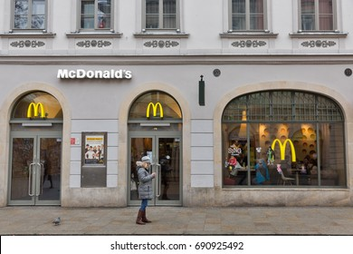 KRAKOW, POLAND - JANUARY 14, 2017: People visit McDonald's restaurant on Florianska street close to Florian Gate in Old Town. McDonald's is the world's largest chain of fast food restaurants.