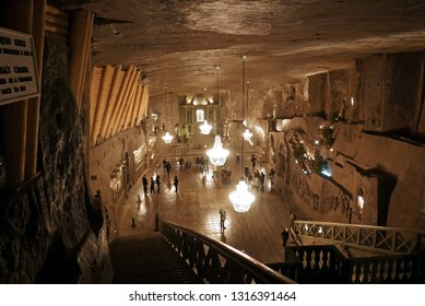 KRAKOW, POLAND -JANUARY 20 2019: People in the Chapel of St. Kinga, the crown jewel of the Wieliczka Salt Mine in Poland