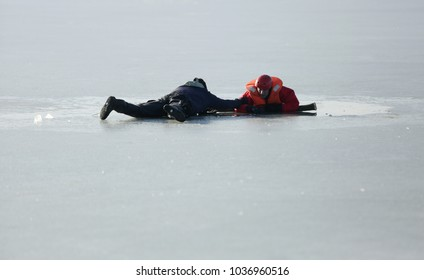 KRAKOW, POLAND - JANUARY 21,2018 : Demonstration action of scuba divers and firefighters on a frozen lake when the ice falls and a man falls into the water