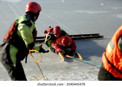 KRAKOW, POLAND - JANUARY 21,2018 : Demonstration action of scuba divers and firefighters on a frozen lake
