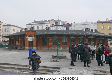 KRAKOW, POLAND -JANUARY 22 2019: People in the picturesque market square with centrally located stall, called Okrąglak in the Kazimierz district