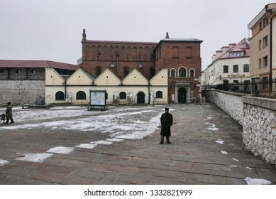 KRAKOW, POLAND -JANUARY 22 2019:People in front of the old Orthodox Jewish synagogue in the Kazimierz district