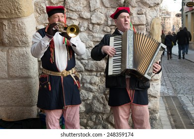 KRAKOW, POLAND - JANUARY 6, 2015: Musicians in Polish traditional costume play on the street.