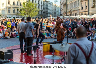 KRAKOW, POLAND - JUL 11, 2015: Unidentified participants at the 28th International Festival of Street Theatres. Annually July 9-12 performances in the Main Square and at random points around the city.