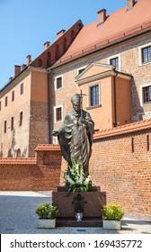 KRAKOW, POLAND - JUL 27, 2013: Statue of Pope John Paul II ( Blessed John Paul or John Paul the Great, Papa Giovanni Paolo II, Karol Jozef Wojtyla ) on Wawel in Krakow, Malopolska, Poland, Europe