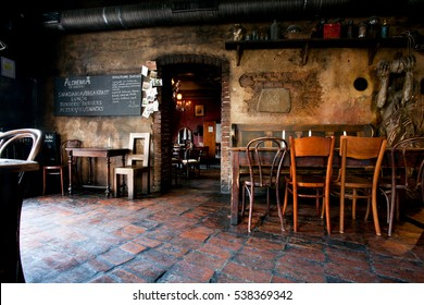 KRAKOW, POLAND - JUL 31: Vintage tables and chairs in stylish undeground bar in ancient building on July 31, 2014. Krakow with popul. of 800,000 people has 2.35 mill. foreign tourists annually.