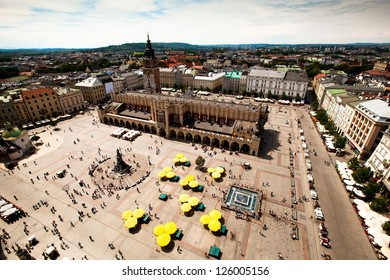 KRAKOW, POLAND - JULY 18: View of the Main Square - historical center of Krakow, May 18, 2012 in Krakow, Poland. This year the city was visited by 8.1 million tourists, which is the highest level.