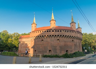 Krakow, Poland - July 27, 2019: Cracow Barbican (Polish: Barbakan Krakowski) in the morning. Barbican – a fortified outpost once connected to the city walls.