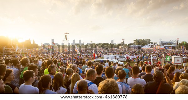 KRAKOW, POLAND - JULY 29, 2016: Pilgrims of the World Youth Day during holy mass on Blonia meadow in Krakow.