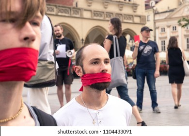 Krakow, Poland, June 01, 2018, Two guys with red ribbon tied mouths protesting against censorship and prohibition of freedom of speech