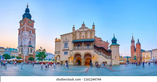 KRAKOW, POLAND - JUNE 11, 2018: The Plac Mariacki in Krakow is one of the most beautiful squares in Poland and is the best place to make evening promenade, on June 11 in Krakow.