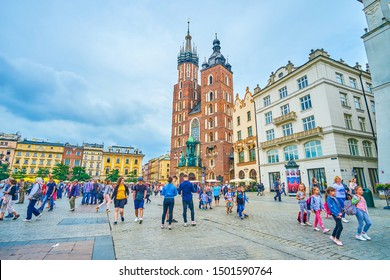 KRAKOW, POLAND - JUNE, 13, 2018: The Rynek Glowny (Main Market Square) is the central square of the city, the most busy place and the tourist center in historical old town, on June 13 in Krakow