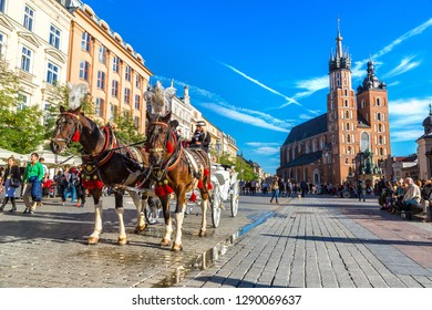 KRAKOW, POLAND - JUNE 16, 2017: Horse carriages at main square in Krakow in a summer day, Poland