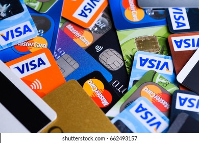 Krakow, Poland - June 16, 2017: Plastic bank payment cards, Visa and Mastercard, credit and debit.