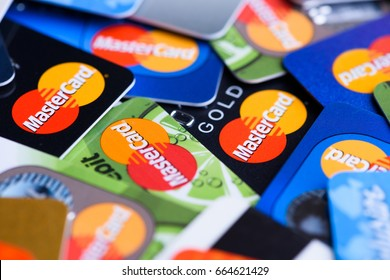 Krakow, Poland - June 16, 2017: Pile of plastic bank Mastercard payment cards.