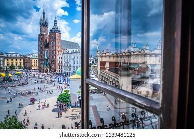 KRAKOW, POLAND - JUNE 16, 2018; Market main square (Rynek Glowny) with Marketplace (Sukiennice), Adam Mickiewicz Monument, Church of Saint Mary (Kosciol Mariacki) and church of Saint Adalbert