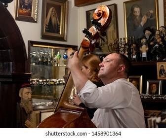 Krakow, Poland. June 2019. Musician playing klezmer music at a restaurant serving Jewish food in Szeroka Street, Kazimierz, the historic Jewish quarter of Krakow.