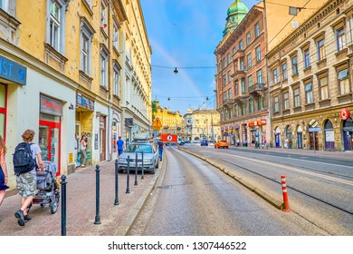 KRAKOW, POLAND - JUNE 21, 2018: Historic Stradomska street with the rainbow above the old edifices, is one of the most busiest places in old Krakow, on June 21 in Krakow.