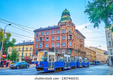 KRAKOW, POLAND - JUNE 21, 2018: The old tram drives along the busy Jozef Dietl avenue, lined with old edifices, on June 21 in Krakow.