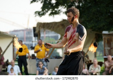 KRAKOW, POLAND - JUNE 21: St. John's Fair festival's fire show on June 21, 2013 in Krakow, Poland. In this performance the actors are fighting with the dragon