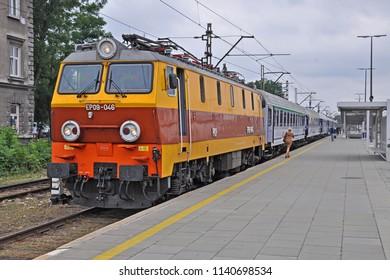 KRAKOW, POLAND - JUNE 27, 2018 - PKP Intercity long-distance carriage train, hauled by EP09 electric loco, at Krakow Plaszow railway station