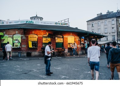 KRAKOW, POLAND - JUNE 28, 2016: People at Plac Nowy (New Square), nice street food place, Jewish quarter.