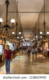 Krakow, Poland June 5, 2018: Interior of gallery of Cloth Hall with visitors walking along the stalls. Cloth Hall is the central feature of Main Market Square in Old Town