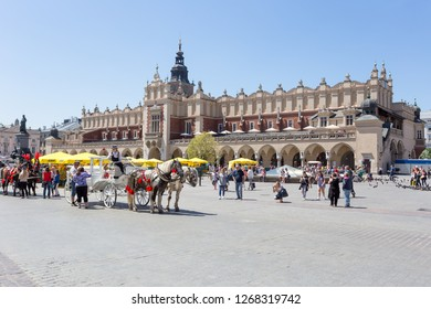 KRAKOW, POLAND - JUNE 9, 2018. Traditional horse carriage in Main Market in front of the Cloth Hall in Krakow, Poland