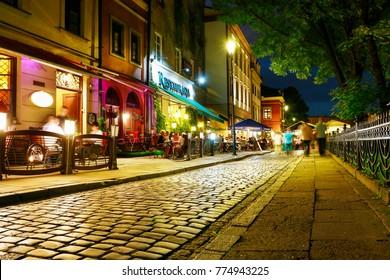 KRAKOW, POLAND - MARCH 03, 2016: Kazimierz, former jewish quarter of Krakow. Popular clubs, pubs and restaurants by night.