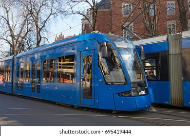 KRAKOW, POLAND - MARCH 28, 2017: Tram Bombardier NGT8 in the historic part of Krakow. Total in Krakow more than 90 kilometers of tram tracks and 24 routes.