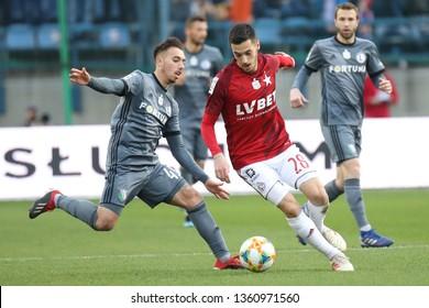 KRAKOW, POLAND - MARCH 31, 2019: Polish Premier Football League Wisla Krakow - Legia Warszawa o/p Vukan Savicevic, Iuri Medeiros