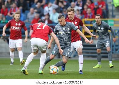 KRAKOW, POLAND - MARCH 31, 2019: Polish Premier Football League Wisla Krakow - Legia Warszawa o/p Carlitos Lopez, Lukasz Burliga, Marcin Wasilewski