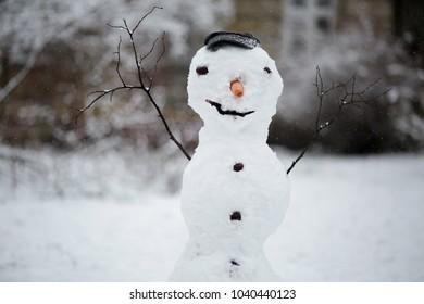KRAKOW, POLAND - MARCH 3,2018 : Winter in krakow.Krakow's night planty in a winter aura.Snowman in the park