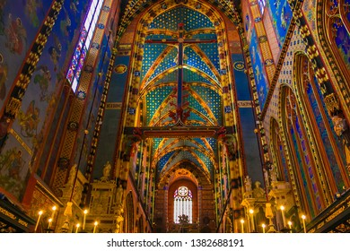 KRAKOW, POLAND - MARCH 7, 2019: Colored interior of Church of Our Lady Assumed into Heaven is a Brick Gothic church adjacent to the Main Market Square in Krakow