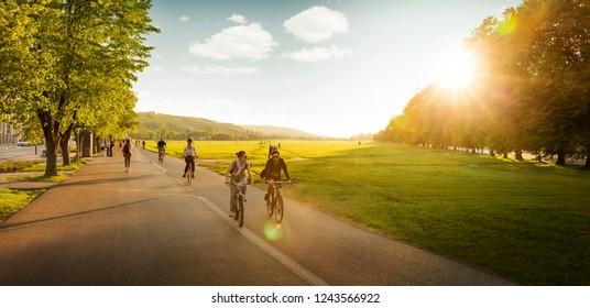 Krakow, Poland - May 18, 2017: People cycling around Blonia meadow in Krakow, Poland