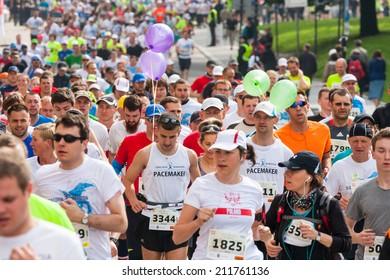 KRAKOW, POLAND - MAY 18 : Cracovia Marathon. Runners on the city streets on May 18, 2014 in Krakow, POLAND