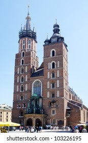 KRAKOW, POLAND - MAY 20: City Square with St. Mary's Church on May 20, 2012 in Krakow, Poland. City Square it is the largest medieval town square in Europe, visited by tourists from around the world.