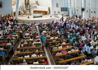KRAKOW, POLAND - MAY 28, 2016: Parishioners and Pilgrims in Basilica of the Divine Mercy of Sanctuary in Lagiewniki. Millions of pilgrims from around the world visit sanctuary every year.