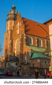 KRAKOW, POLAND - NOV 04, 2014:  Basilica of Corpus Christi. One of the biggest churches in Poland. Architecture and streets of the old town. Picture taken during a trip to Krakow.