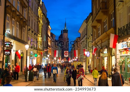 KRAKOW, POLAND - NOV 10, 2014: People walking on Old Town street of Krakow. Krakow Old Town - one of most famous old districts in Poland today and was the center of Poland's political life from 1038