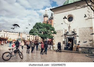 a44acf2627541 KRAKOW, POLAND - November 11 2017: Unidentified tourists visiting main  market square in Krakow. Bike flat icon