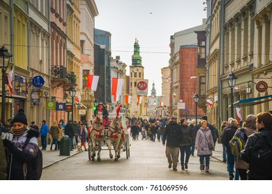 KRAKOW, POLAND: NOVEMBER, 11, 2017. Cityscape of old town, tourists and citizens walking on Florianska street, view of town hall on background.