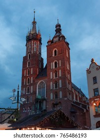 Krakow, Poland, November 2017: St. Mary Basilica view from the Main Market Square, city center panorama at evening with Christmas decoration