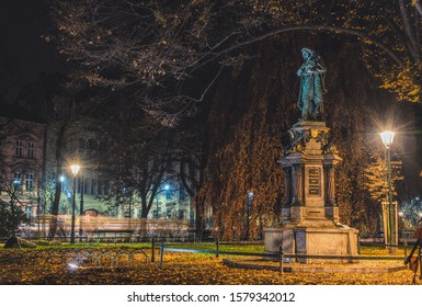Krakow / Poland - November 30 2019: ancient statue of the medieval scientist astronomer Nikolai Copernicus (Nicolaus Copernik) in a park opposite the ancient Royal Jagiellonian University in Krakow