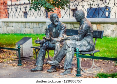 Krakow, Poland - October 10, 2018: Memorial bench of famous Polish mathematicians Stefan Banach and Otto Nikodym - bronze artwork created by Stefan Dousa, located in Planty Park of Krakow since 2016