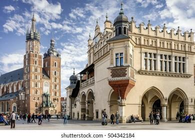 KRAKOW, POLAND - OCTOBER 24, 2016: Sukiennice and Mariacki Church at the Main Market Square (Rynek) in Krakow, Poland.